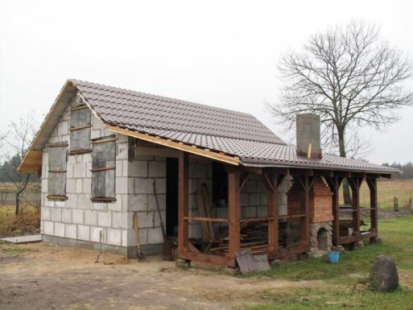Проекты домов с мансардой и гаражом на одну и две машины